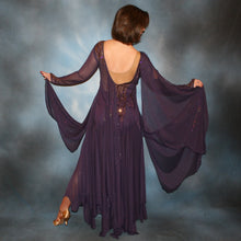 Load image into Gallery viewer, Crystal's Creations back view of Purple ballroom dress created in gorgeous deep plum iridescent sheer mesh with draping floats, embellished with gold aurum & purple velvet Swarovski rhinestone work