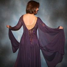 Load image into Gallery viewer, Crystal's Creations close up of back of Purple ballroom dress created in gorgeous deep plum iridescent sheer mesh with draping floats, embellished with gold aurum & purple velvet Swarovski rhinestone work