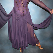 Load image into Gallery viewer, Crystal's Creations close up of bottom of Purple ballroom dress created in gorgeous deep plum iridescent sheer mesh with draping floats, embellished with gold aurum & purple velvet Swarovski rhinestone work