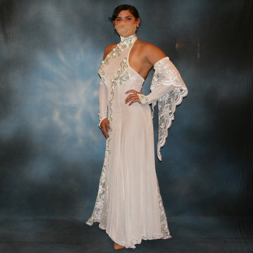 Crystal's Creations White ballroom dance dress was created in luxurious white stretch velvet with sequined lace insets & arm float, embellished with green peridot Swarovski detailed rhinestone work & miniature silk roses