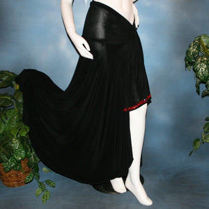 right side view of Black Sarong wrap style ballroom skirt created in luxurious black solid slinky with light siam Swarovski rhinestone work on sash edges.