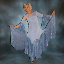 Load image into Gallery viewer, Crystal's Creations Periwinkle ballroom dress of glitter slinky with periwinkle iridescent sheer large skirt flounces with a subtle texture, one long sleeve, one arm embellishment with flounces & back detail straps…