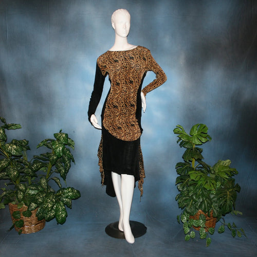 Ballroom social slinky dance set consisting of a black slinky Latin/rhythm skirt with serengeti print slinky & matching tunic top with color blocking & open detailing work in the long sleeves. The tunic top can be worn separately as a Latin/rhythm dress with dance trunks or a shorter little skirt can be custom made to go with it for an extra fee. You can also team the slinky tunic with pants. This slinky Latin/rhythm skirt & top is great for ballroom teachers!