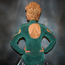 Load image into Gallery viewer,  Crystal's Creations back close view of Teal Latin/rhythm dress was created in luxurious teal solid slinky with teal & rose metallic brocade peacock print flounces, & embellished with fuchsia Swarovski rhinestone detailing