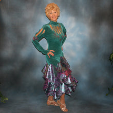 Load image into Gallery viewer, Crystal's Creations side view of Teal Latin/rhythm dress was created in luxurious teal solid slinky with teal & rose metallic brocade peacock print flounces, & embellished with fuchsia Swarovski rhinestone detailing