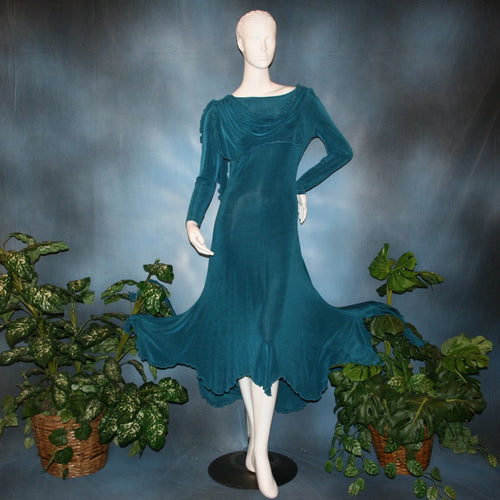 Blue social ballroom dress created in deep blue luxurious solid slinky fabric with attached draping on shoulders & scalloped skirt edge. Very full around bottom & can be a beginner ballroom dancer smooth dress.