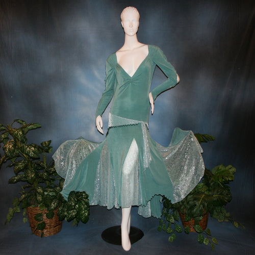 Aqua social ballroom dress created in luxurious aqua solid slinky fabric with aqua iridescent sheer insets, embellished with hand beading of Swarovski beads on hip sash. Very full around bottom...can be a beginner ballroom dancer smooth ballroom dress.