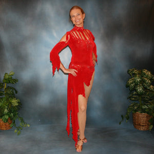 Crystal's Creations Red Latin/rhythm dress, which consists of a bodysuit, featuring cutouts in bodice with a keyhole back, 3/4 sleeves with details & Latin/rhythm skirt, was created in luxurious red solid slinky embellished with light siam Swarovski rhinestone work.