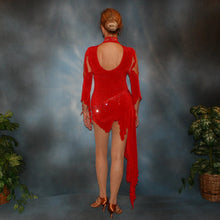 Load image into Gallery viewer, Crystal's Creations back view of Red Latin/rhythm dress, which consists of a bodysuit, featuring cutouts in bodice with a keyhole back, 3/4 sleeves with details & Latin/rhythm skirt, was created in luxurious red solid slinky embellished with light siam Swarovski rhinestone work.