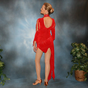 Crystal's Creations back view of Red Latin/rhythm dress, which consists of a bodysuit, featuring cutouts in bodice with a keyhole back, 3/4 sleeves with details & Latin/rhythm skirt, was created in luxurious red solid slinky embellished with light siam Swarovski rhinestone work.