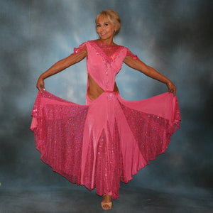Crystal's Creations Pink ballroom dress was created of luxurious bubble gum pink solid slinky with yards & yards of delicate deep pink sequin insets & is embellished with CAB & rose Swarovski detailed rhinestone work