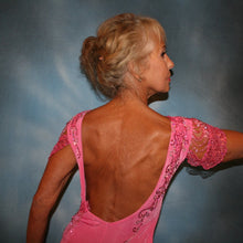Load image into Gallery viewer, Crystal's Creations close up back view of Pink ballroom dress was created of luxurious bubble gum pink solid slinky with yards & yards of delicate deep pink sequin insets & is embellished with CAB & rose Swarovski detailed rhinestone work