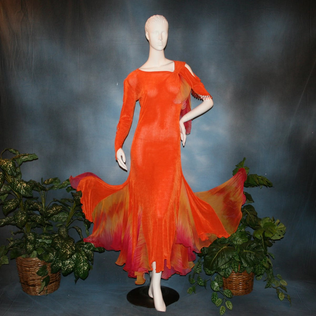 Orange social ballroom dress created in luxurious solid slinky fabric with chiffon insets of rainbow oranges & yellows, with hand beading on arm draping. Very full around bottom, and makes a great beginner ballroom dancer smooth dress.