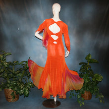 Load image into Gallery viewer, back view of Orange social ballroom dress created in luxurious solid slinky fabric with chiffon insets of rainbow oranges & yellows, with hand beading on arm draping. Very full around bottom, and makes a great beginner ballroom dancer smooth dress.