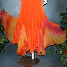 Load image into Gallery viewer, lower close view of Orange social ballroom dress created in luxurious solid slinky fabric with chiffon insets of rainbow oranges & yellows, with hand beading on arm draping. Very full around bottom, and makes a great beginner ballroom dancer smooth dress.