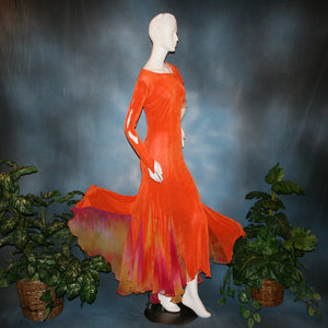 side view of Orange social ballroom dress created in luxurious solid slinky fabric with chiffon insets of rainbow oranges & yellows, with hand beading on arm draping. Very full around bottom, and makes a great beginner ballroom dancer smooth dress.