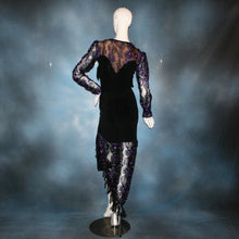 Load image into Gallery viewer, back view of Black & purple bodysuit & hip wrap style Latin/rhythm dance skirt made of black luxurious solid slinky & gorgeous metallic black & deep purple soutache lace. Opaque nude fabric is behind the lace on the bodice, so it can be worn with a bra. The skirt also features ribbon fringe along with Swarovski hand beading of Swarovski beads in various shapes on the skirt sash.