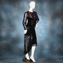 Load image into Gallery viewer, side view of Black & purple bodysuit & hip wrap style Latin/rhythm dance skirt made of black luxurious solid slinky & gorgeous metallic black & deep purple soutache lace. Opaque nude fabric is behind the lace on the bodice, so it can be worn with a bra. The skirt also features ribbon fringe along with Swarovski hand beading of Swarovski beads in various shapes on the skirt sash.