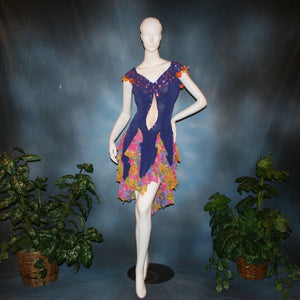Crystal's Creations Converta ballroom dress featuring a Latin/rhythm dress created in luxurious deep perwinkle solid slinky with lots of flounces in accents of a floral chiffon in yellow with pinks & purples