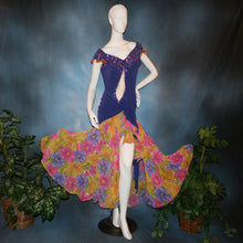 Load image into Gallery viewer, Crystal's Creations Converta ballroom dress featuring a Latin/rhythm dress created in luxurious deep perwinkle solid slinky with lots of flounces in accents of a floral chiffon in yellow with pinks & purples