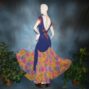 Crystal's Creations back view of Converta ballroom dress featuring a Latin/rhythm dress created in luxurious deep perwinkle solid slinky with lots of flounces in accents of a floral chiffon in yellow with pinks & purples