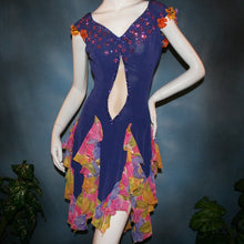 Load image into Gallery viewer, Crystal's Creations close up view of Converta ballroom dress featuring a Latin/rhythm dress created in luxurious deep perwinkle solid slinky with lots of flounces in accents of a floral chiffon in yellow with pinks & purples