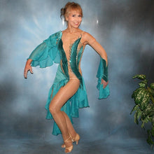 Load image into Gallery viewer, Crystal's Creations Teal Latin/rhythm dress was created on a nude illusion base with luxurious teal glitter stretch velvet fabric along with flounces of teal glitter chiffon, embellished with blue zircon & blue zircon Ab Swarovski stonework plus hand beaded detailing