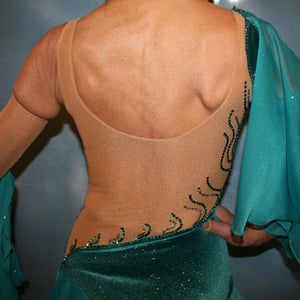 Crystal's Creations close up back view of Teal Latin/rhythm dress was created on a nude illusion base with luxurious teal glitter stretch velvet fabric along with flounces of teal glitter chiffon, embellished with blue zircon & blue zircon Ab Swarovski stonework plus hand beaded detailing