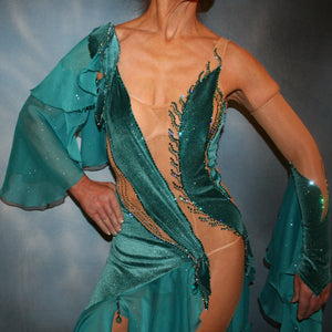 Crystal's Creations close up view of Crystal's Creations close up view of Teal Latin/rhythm dress was created on a nude illusion base with luxurious teal glitter stretch velvet fabric along with flounces of teal glitter chiffon, embellished with blue zircon & blue zircon Ab Swarovski stonework plus hand beaded detailing