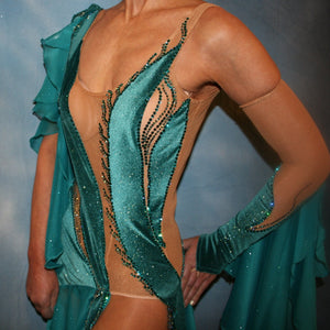 Crystal's Creations close up view of Teal Latin/rhythm dress was created on a nude illusion base with luxurious teal glitter stretch velvet fabric along with flounces of teal glitter chiffon, embellished with blue zircon & blue zircon Ab Swarovski stonework plus hand beaded detailing