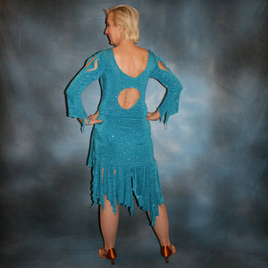 back view of Turquoise Latin/rhythm skirt & bodysuit featuring keyhole back & flaired sleeves of turquoise with a touch of purple glitterknit slinky,  only one of this exact fabric.