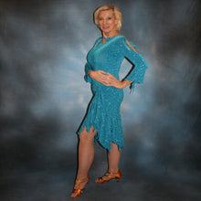Load image into Gallery viewer, left side view of Turquoise Latin/rhythm skirt & bodysuit featuring keyhole back & flaired sleeves of turquoise with a touch of purple glitterknit slinky,  only one of this exact fabric.