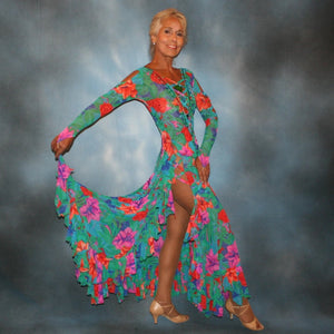 Crystal's Creations Gorgeous green tropical print Latin/rhythm dress with orange, pink & purple flowers in the print has lots of flounces up & around the high slit thighs, embellished with Swarovski rhinestone work, along with lattice strap detailing & hand beading.