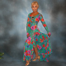 Load image into Gallery viewer, Crystal's Creations left side view of Gorgeous green tropical print Latin/rhythm dress with orange, pink & purple flowers in the print has lots of flounces up & around the high slit thighs, embellished with Swarovski rhinestone work, along with lattice strap detailing & hand beading.