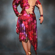 Load image into Gallery viewer, lower back view of Tropical print Latin/rhythm dress created in tropical print lycra in burgundies & purples on a nude illusion base, embellished lavishly with Swarovski rhinestone work in burgundies, purples, orchids & a touch of the greens & golds that are within the print.