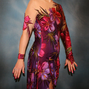 close side view of Tropical print Latin/rhythm dress created in tropical print lycra in burgundies & purples on a nude illusion base, embellished lavishly with Swarovski rhinestone work in burgundies, purples, orchids & a touch of the greens & golds that are within the print.