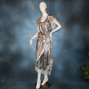 Crystal's Creations Silver two panel Latin/rhythm skirt & top that has hand beading on neck edge of textured silver beads, with metallic fringe, was created of a leopard print knit with silver metallic on one side.