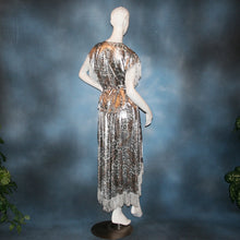 Load image into Gallery viewer, Crystal's Creations back view of Silver two panel Latin/rhythm skirt & top that has hand beading on neck edge of textured silver beads, with metallic fringe, was created of a leopard print knit with silver metallic on one side.