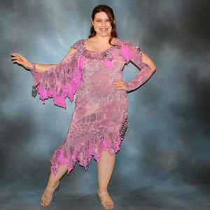 Crystal's Creations Orchid Latin/rhythm dress created of wild orchid & violet printed glitter slinky has orchid accents, flounces on one arm & skirt, embellished with Swarovski hand beading of various shades of orchid & shapes through out, is a fun & colorful Latin/rhythm dress