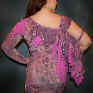 Crystal's Creations close back view of Orchid Latin/rhythm dress created of wild orchid & violet printed glitter slinky has orchid accents, flounces on one arm & skirt, embellished with Swarovski hand beading of various shades of orchid & shapes through out, is a fun & colorful Latin/rhythm dress