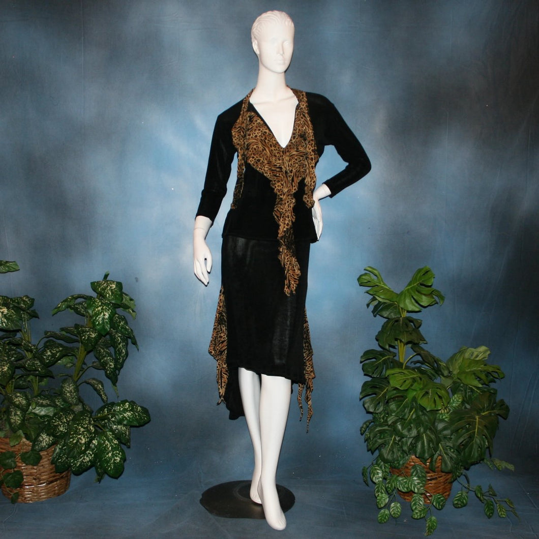 Black ballroom dance top with cheetah ruffly neck & tie of luxurious black slinky and black Latin/rhythm flaired skirt with cheetah print slinky ruffly accents, which drapes down longer in the back. Great set for ballroom teachers!Tie on top can be worn open or closed.