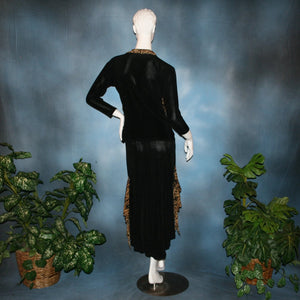 back view of Black ballroom dance top with cheetah ruffly neck & tie of luxurious black slinky and black Latin/rhythm flaired skirt with cheetah print slinky ruffly accents, which drapes down longer in the back. Great set for ballroom teachers!Tie on top can be worn open or closed.