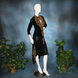 right side view of Black ballroom dance top with cheetah ruffly neck & tie of luxurious black slinky and black Latin/rhythm flaired skirt with cheetah print slinky ruffly accents, which drapes down longer in the back. Great set for ballroom teachers!Tie on top can be worn open or closed.