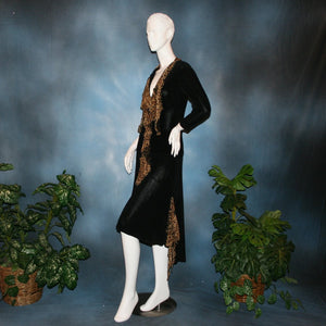 side view of Black ballroom dance top with cheetah ruffly neck & tie of luxurious black slinky and black Latin/rhythm flaired skirt with cheetah print slinky ruffly accents, which drapes down longer in the back. Great set for ballroom teachers!Tie on top can be worn open or closed.