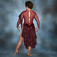Load image into Gallery viewer, Crystal's Creations back view of Burgundy stretch velvet Latin/rhythm dress created on burgundy stretch mesh base with rose patterned clip/cut chiffon, is embellished with burgundy, fuchsia, antique rose, & orchid Swarovski rhinestone work & a touch of Swarovski hand beading.