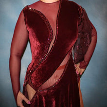 Load image into Gallery viewer, Crystal's Creations close up view of Burgundy stretch velvet Latin/rhythm dress created on burgundy stretch mesh base with rose patterned clip/cut chiffon, is embellished with burgundy, fuchsia, antique rose, & orchid Swarovski rhinestone work & a touch of Swarovski hand beading.