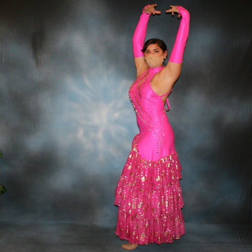 Crystal's Creations Fuchsia tango dress created of textured fuchsia lycra with ruffles of gold leafed patterned chiffon, nude illusion cutouts & low back, is embellished with gold aurum Swarovski rhinestone work & hand beading.