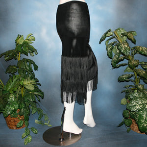 back view of Black fringy hip wrap Latin/rhythm skirt, was created of luxurious black solid slinky, with 4 rows of black chainette fringe.