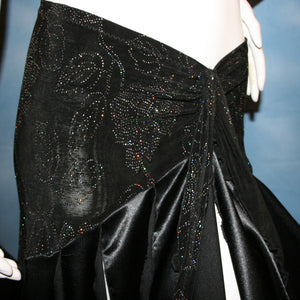 close view of Black ballroom skirt created with a beautifully patterned glitter slinky sarong hip sash piece that flairs out to yards of black satin panels, would pair beautifully with a black body suit or one could be custom created for an extra fee.