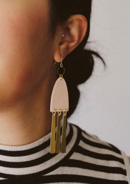Studio Toujours FLUTTER earrings - polymer clay statement earrings. Blush pink with a light shimmer with dangling raw brass, inspired by the grace and movement of wind chimes